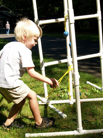 Josiah playing ladder golf