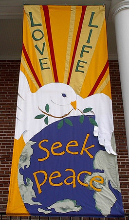 """Love Life, Seek Peace"" banner made by Mary Lou Cummings & me, 2003. With added paint."
