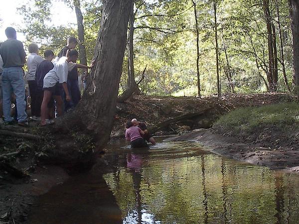 Baptisms in the creek at Camp Men-O-Lan, Sept. 2003