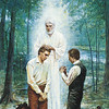 Joseph Smith, Jr. and Oliver Cowdery kneeling before John the Baptist. John the Baptist has his hands placed on the head of Joseph Smith, Jr. as he restores the Aaronic Priesthood. John is depicted wearing white. There are trees and a river in the background.