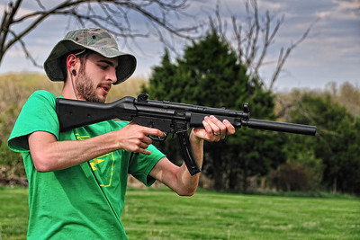 Dave fires a fully-automatic H&K MP5 chambered for 22 cal.