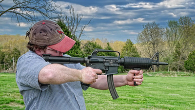 Josh firing a fully automatic AR-15 with a 22 cal conversion kit.