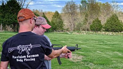 Wayne helps Josh with the AR-15.