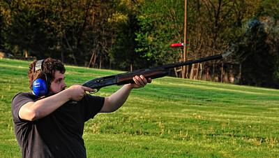 Justin shoots skeet.