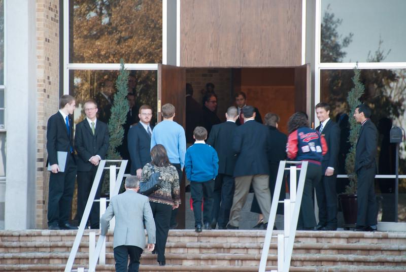Seminarians greeting visitors before Mass