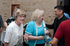 Betty Monaghan, Mary Kay Whaley, and Father Rudy Garcia enjoy a laugh before Mass
