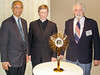 Chainarong Monthienvichienchai, 2004-2005 Serra International President; Bishop Blase Cupich; and Tony Plaia, 2004-2005 President of the Serra USA Council with the vocations monstrance