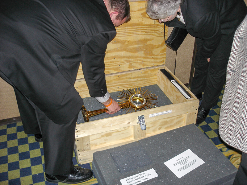 Serrans packing the vocations monstrance for shipping