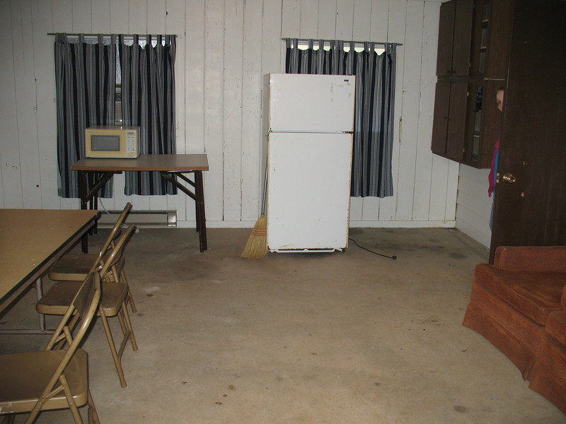 This is the common area on cabin S-10  They are going to carpet it before summer.  I don't think it's big enough for 27 people, but it does have a fridge.
