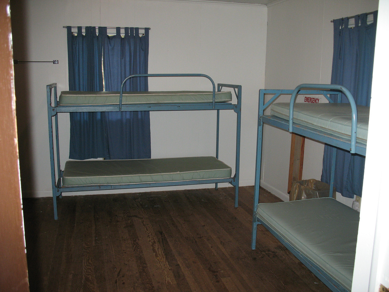 Inside of cabin S-10 (one choice for boys cabin).  There are 2 separate sleeping rooms each with 6 beds and a common area for gathering