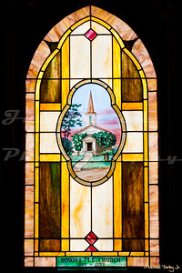 Sonora United Methodist Church, built in 1923.   A window honoring the previous incarnation of the church building.