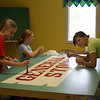 Mary, Anna, and Katherine work on the general store sign.