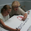 Mary Nerren and I, painting the Hard Times Cafe sign.