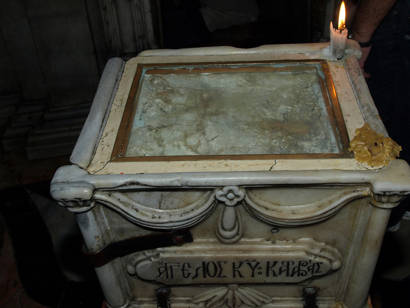 Holy Sepulchre.  Inside the edicule; a fragment of the stone believed to have sealed Jesus' tomb.