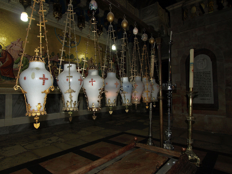 Holy Sepulchre; lanterns over the Stone of Anointing.