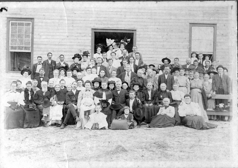 The Salem Primitive Baptist Church, also known as the Lime Sink Church in Adel, Georgia. Photo taken about 1910. Identified: Effie Shaw Clements, right front on ground.