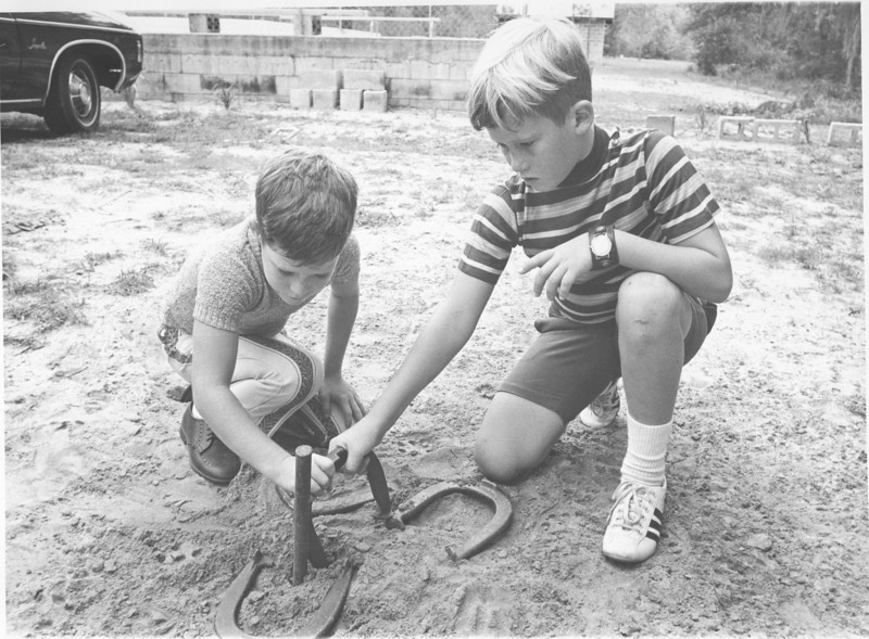 Camp Tygart camp meeting horse shoes Aug 1971<br /> <br /> The Berrien Press, page 6, August 12, 1971<br /> photo caption:<br /> Youth activities play a large part at the camp.  A number of games and recreation facilities are available.  Joey and Jeff Jenkins of Quitman play a game of horeshoes.