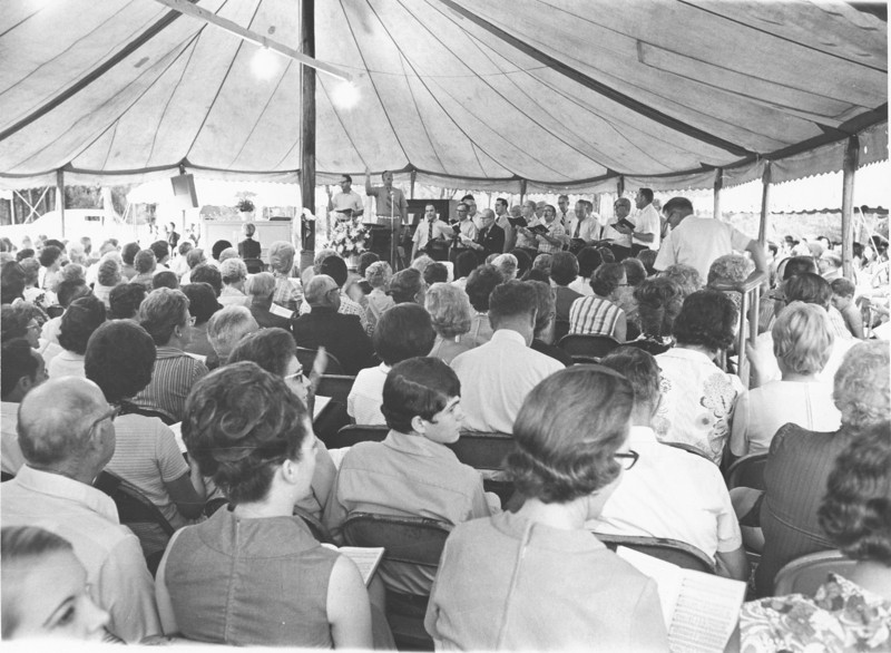 Camp Tygart camp meeting Aug 1971<br /> <br /> The Berrien Press, front page, August 12, 1971<br /> Photo caption:<br /> CAMP MEETING – Methodists of the Valdosta District, as well as other denominations of the area, attended the camp meeting last week at Camp J.D. Tygart, south of Nashville.  Here's a wide-angle view of the song service as seen under the big tent.  Smaller tents were all around this one.  A photo feature on the camp meeting is on page 6.