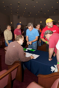 Signing in before leaving for Harvest.  Even Tommy had to register and get a wrist band!!
