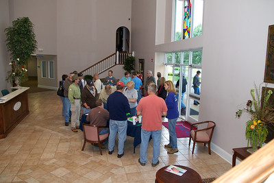 Signing in at the church before leaving for Harvest.