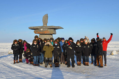 Group photo in Churchill, Sam one of the guides is wearing a red jacket. Two people wore their own jackets.