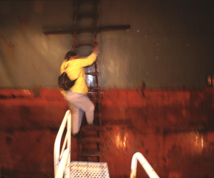 Bill Shields bording ship at night in rough seas