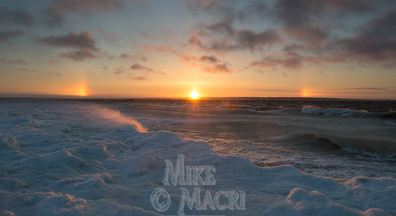 Grease ice forming on Churchill River with late day sun dogs.