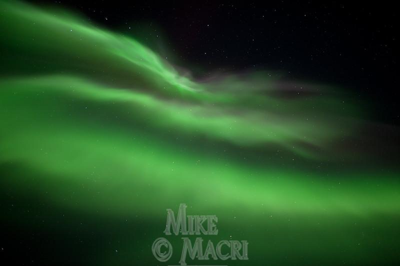 Aurora borealis under big dipper.