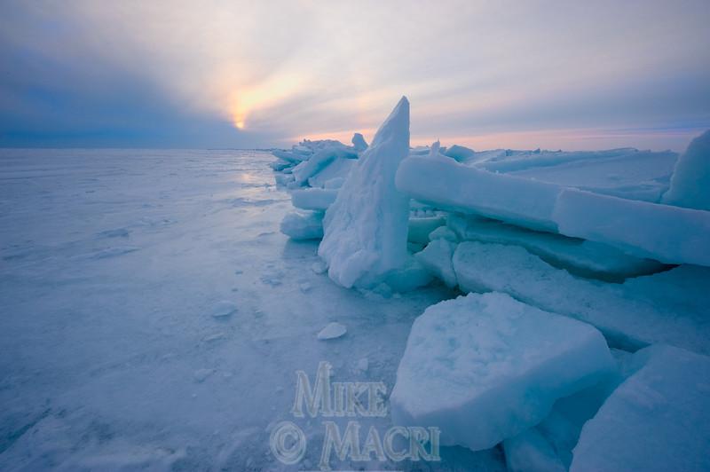 Sun setting over Hudson Bay pressure ice.