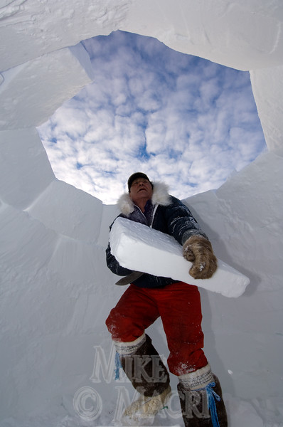 Peter building igloo.