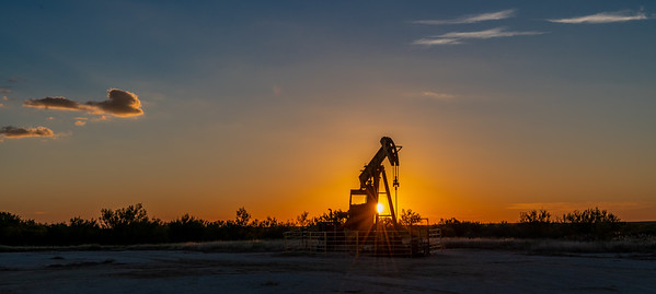 Pump Jack in setting sun foreground