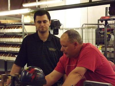 Professor Russ & Kertis weighing a ball.
