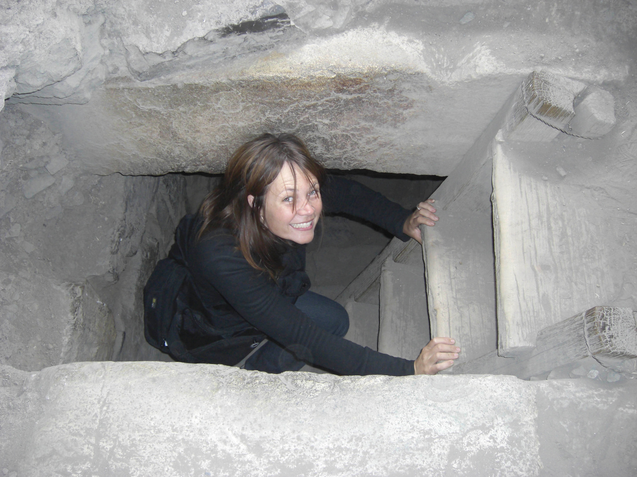 Climbing into the catacombs in Chavin