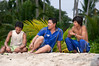 Copra workers taking a break on the beach, Simeulu Island, Sumatra