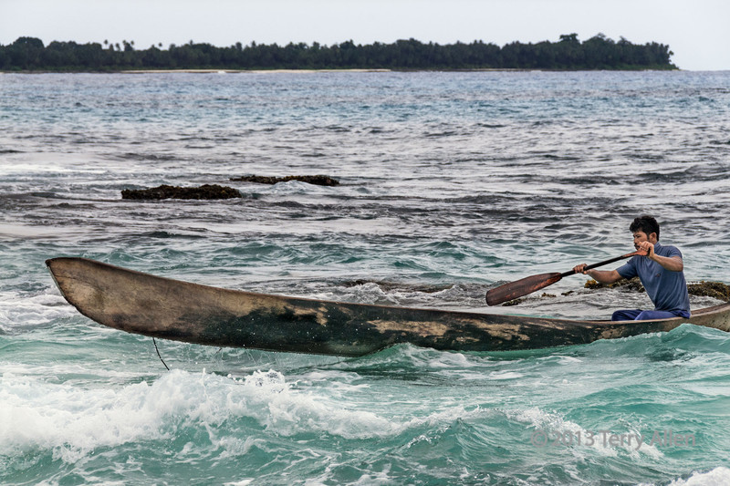 Dugout canoe in the surf