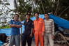 Copra workers posing at their camp, Simeulu Island, Sumatra