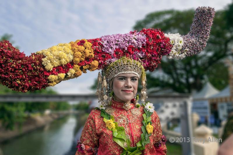 Acehnese woman in elaborate flowered headdress, Banda Aceh, Sumatra
