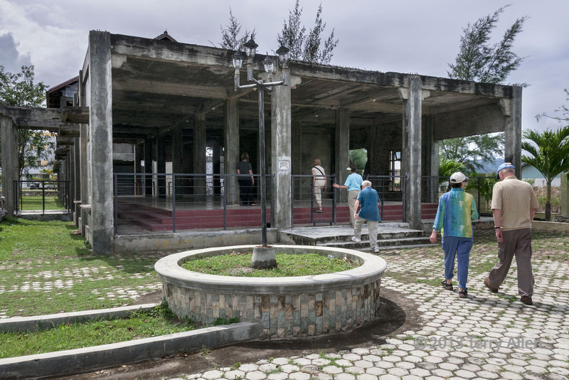 The-frames-of-the-hospital-building-survived-the-tsunami,-Banda-Aceh,-Sumatra<br /> <br /> The sturdily built hospital was in the direct path of the tsunami, but the skeltons of the building remained standing.  It is now the site of a mass grave for unidentified victims.  The latest estimate is that approximately 220,000 people lost their lives in the tsunami.
