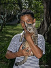 Boy-and-his-kitten,-Bukit-Lawang,-North-Sumatra