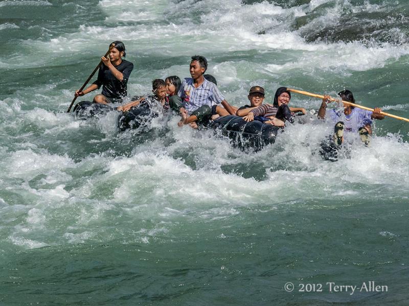 Sumatrans-enjoying-tubing,-Bahorok-River,-North-Sumatra