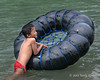 Boy-playing-with-an-inner-tube-2,-Bukit-Lawang,-North-Sumatra