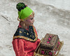 Woman in traditional dress with gift box, Belitung Island, Sumatra