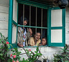 Batak-girls-peeking-through-window,-Lingga-Brastagi,-North-Sumatra