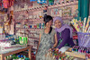 Pair of shop girls in a drug store, Bengkulu market, Southwest Sumatra