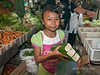 "Gotta love markets!<br /> <br /> Young girl selling food at the market, Bengkulu, Southwest Sumatra.  Can anyone identify this indigenous leaf-wrapped food?  The nearest I could come was some kind of lemper, e.g., lemper ayam (glutinous rice with chicken breast strips wrapped in a banana leaf), except it doesn't look like chicken embedded in the rice.<br /> <br /> This was a covered indoor market and quite dark, necessitating the use of flash fill. Other photos from the market can be seen here: <a href=""http://goo.gl/sEfZUu"">http://goo.gl/sEfZUu</a><br /> <br /> 13/03/14  <a href=""http://www.allenfotowild.com"">http://www.allenfotowild.com</a>"