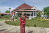 Woman in traditional dress greeting visitors at Sarkono's house (the first Indonesian president), Bengkulu, Southwest Sumatra