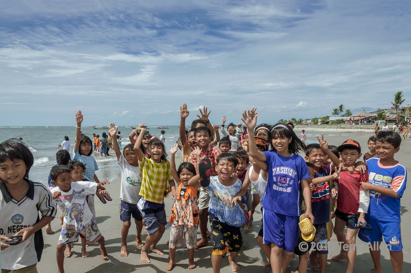 """One of the best things about travelling to remote areas that rarely see foreigners is the genuine, spontaneous delight of the children when they see you coming. This photo captures the moment.<br /> <br /> Other photos of the festivities in Bengkulu at the Sukarno house can be seen here: <a href=""""http://goo.gl/MSJ9hH"""">http://goo.gl/MSJ9hH</a><br /> <br /> 12/3/14  <a href=""""http://www.allenfotowild.com"""">http://www.allenfotowild.com</a>"""