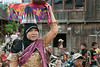 Woman headed to the welcome ceremonies with offerings carried on her head, Liwa, West Lampung, Sumatra