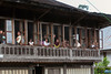 Traditional house with local spectators at the windows, Liwa, West    Lampung, Sumatra