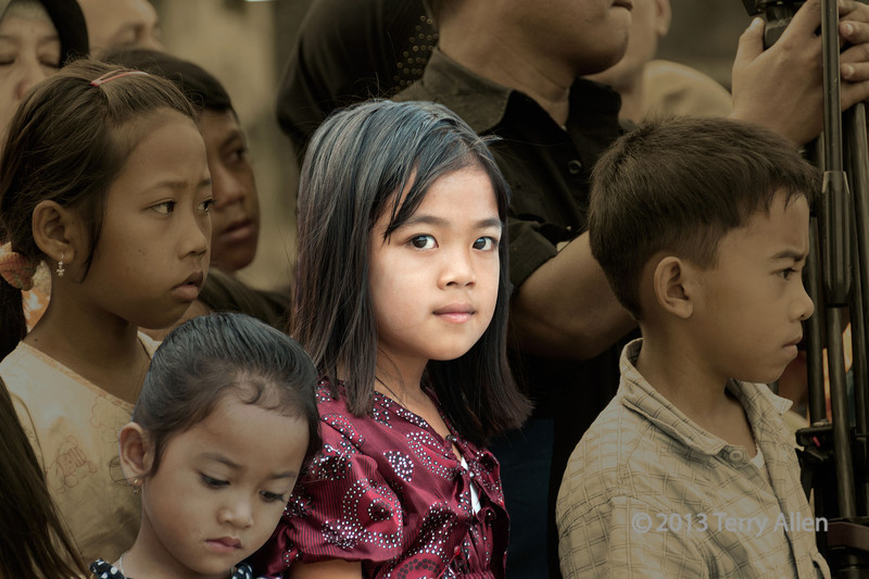 """The Look<br /> <br /> All the villagers were watching a welcoming ceremony for us when we arrive at Krui in West Lampung Province, Sumatra.  As I watched the crowd, this girl turned around and looked directly at me.   I processed the photo with selective colour so she stood out from the others, since she stood out from the crowd when she turned and gave me The Look.<br /> <br /> More photos from Southwest Sumatra can be seen here: <a href=""""http://goo.gl/0dYwSc"""">http://goo.gl/0dYwSc</a><br /> <br /> 17/03/14   <a href=""""http://www.allenfotowild.com"""">http://www.allenfotowild.com</a>"""